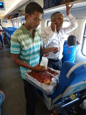 Man selling peanuts on the train - Devilled Peanuts