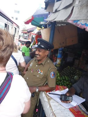 Colombo Police Officer watching the Pettah holiday traffic