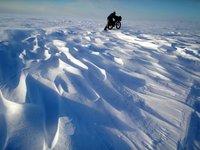 Bill Merchant pushing his bike along the Iditarod Trail near Elim Alaska
