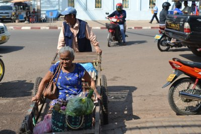 Lady and her purchases leaving the market, Vientiane
