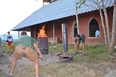 Making coal for water filtration at Pun Pun