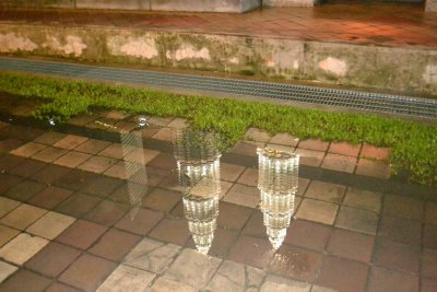 Reflection of the towers in a puddle after a rain shower