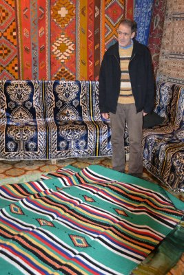 Sit, have mint tea, and buy my rugs...
