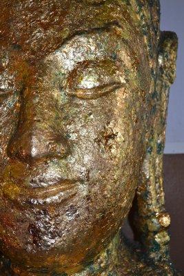 Gold leaf on Buddha's head