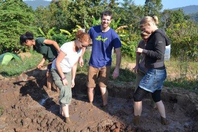 Preparing the mud to make bricks at Pun Pun