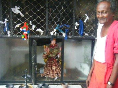 Priest with idol
