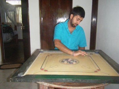 Sully reliving his youth with a game of Carom