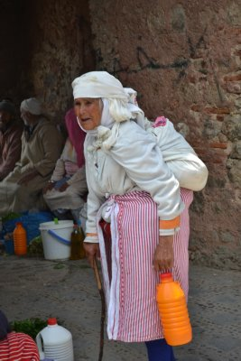 Chefchaouen lady walking home from the market