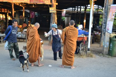 Monks collecting alms in a small village
