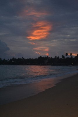 Orange sunset at Unawatuna beach