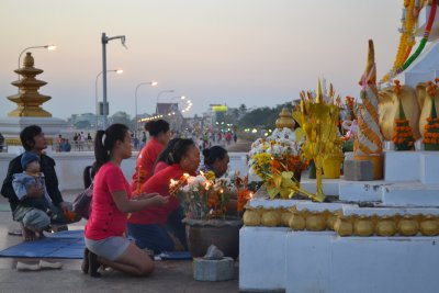 Family at prayer at the riverside, Vientiane