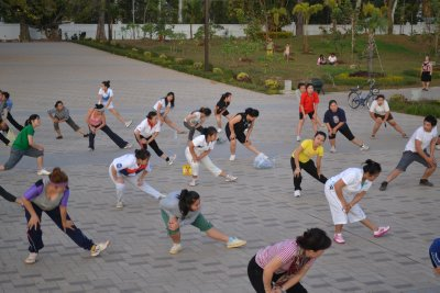 Communal workout session at riverside park, Vientiane