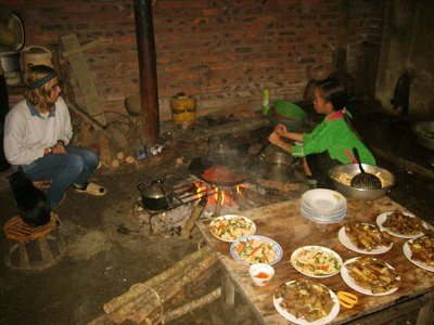 Cooking a dinner for 20 people in the home-stay's one wok in Sapa