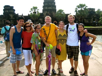 Our Cambodian Crew in front of Angkor Wat after the clouds cleared