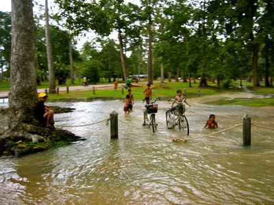 When it storms, Cambodia turns into a massive water park for these kids!