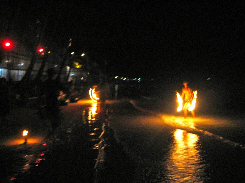 Fire dancers doing their thing at night