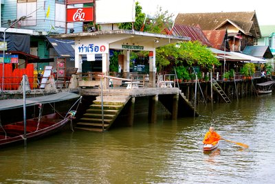 Here's our monk paddling down the river for his morning rounds!