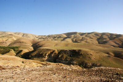 Bedouine tents dotted around the moutainous landscape in the nort-west Jordan