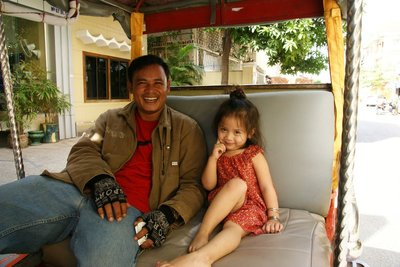 My tuk tuk driver with his little princess
