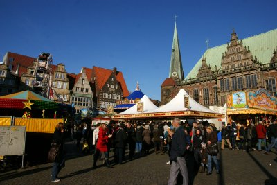 Old town square in Bremen full of funfair rides and stalls