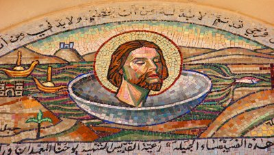 Head of John the Baptist decorating the main entrance into St. John's Church in Madaba
