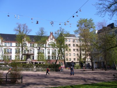 School grounds with shoes hanging on wires above the playground