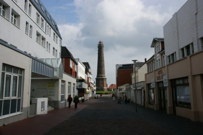 Streets of Borkum town with the lighthouse at the background