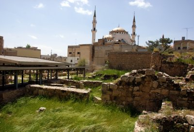 Madaba outdoor Archeological Park with plenty of fascinating mosaics, remains of Roman road and houses, neighbouring a mosque