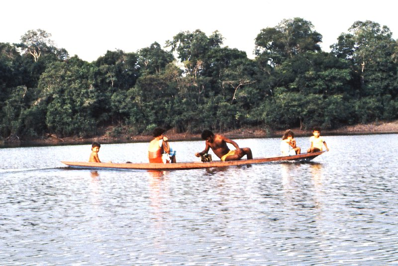 Family on boat on an Amazon tributary river