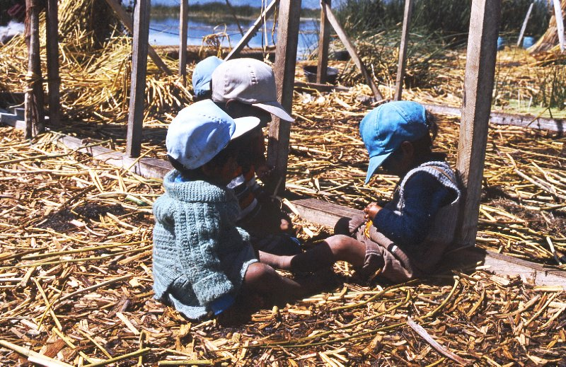Children on floating islands of Los Uros