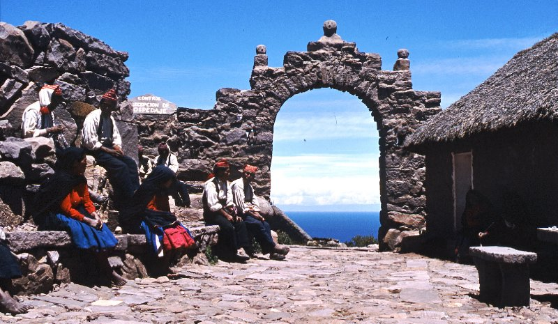 Reception committee on Island of Taquile, Titicaca. These people would wait for arriving boats from Puno on top of the steep slope, welcoming visitors to stay in their homes.