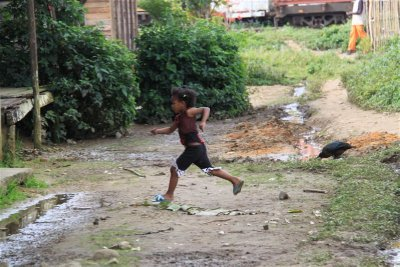 Girl running back home for cover after seeing a Vazaha (Etranger)