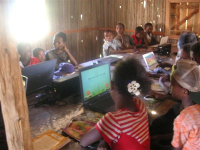 Kids discovering computers in Vohibola