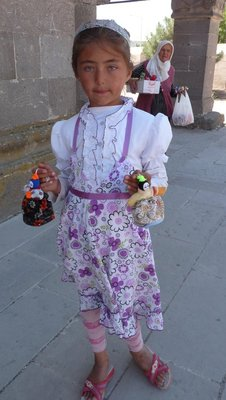Little girl selling dolls