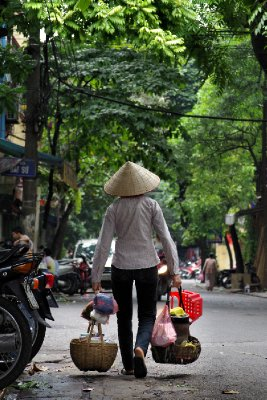 One of the many women who travel to Hanoi on a daily basis to earn a meagre living as a street trader