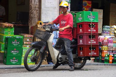 A typical scene in the Old Quarter, where all manner of goods are transported by motorbike