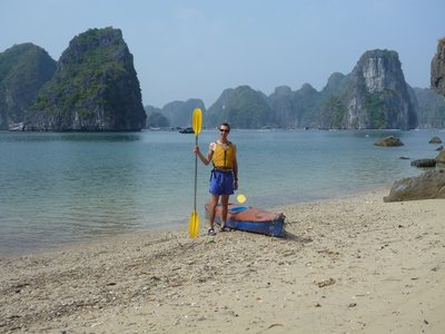 Chris with our kayak at a deserted beach in Halong Bay