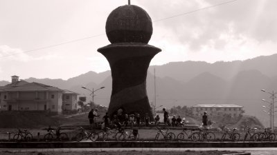 Cyclists dwarfed by a roundabout monument in Vietnam - but what is it?