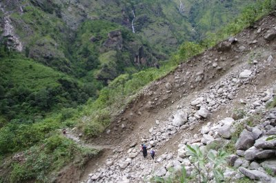 Jen and Ram crossing the landslide after Dobhan