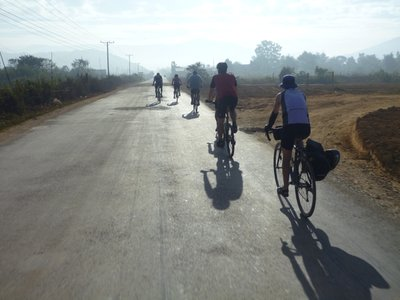 The Red Spokes group on the road in Laos
