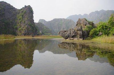 The dramatic karst scenery of Van Long Nature Reserve, North Vietnam