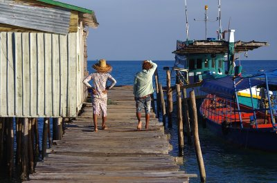 Two boys on the pier at the fishing village