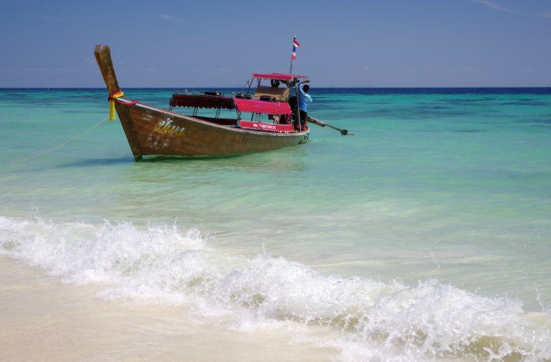 Longtail boat in a turquoise sea