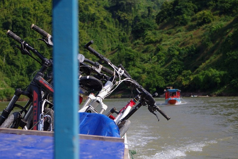 Our bikes go on a boat trip on the Nam Ou River