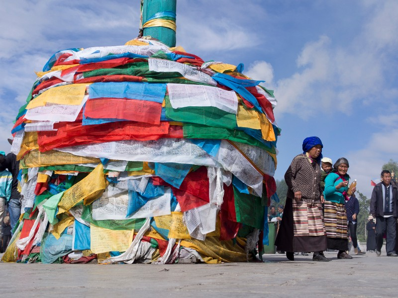 Pilgrims and prayer flags at Jokhang Temple
