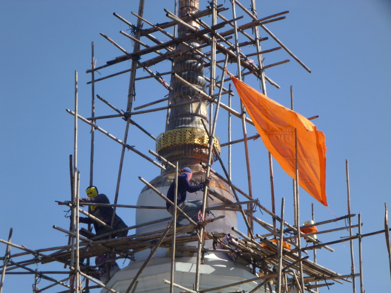 Scaffolders working on a chedi in Chiang Mai