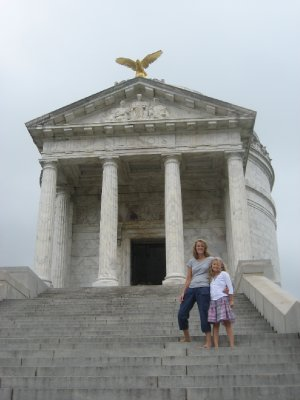 Amy and Mia on steps of Illinois Monument at Vicksburg National Military Park