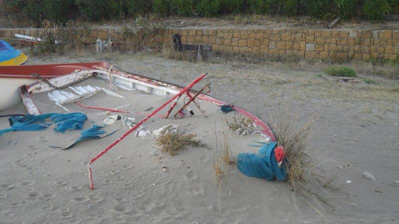 Abandoned rowboat on beach, Torreguadiaro.