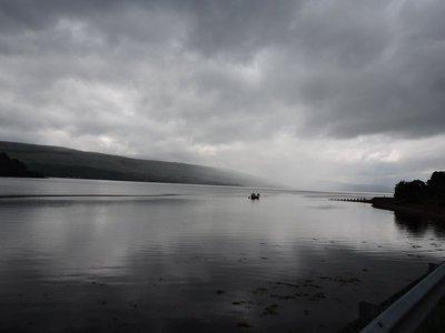 Rain hits the lake at midday
