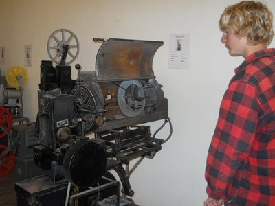 A very old film projector in the Museum of Cinema